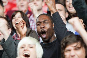 Cheering man at football match